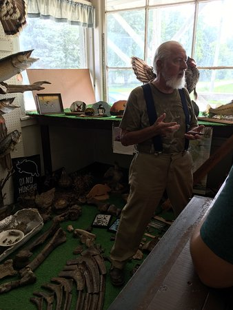 Elkhorn, WI: Jim Boyd holding a Tyrannosaur claw. His life experiences are treasures!