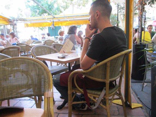 Hotel Burrhus: our server having a smoke next to us....lol how French