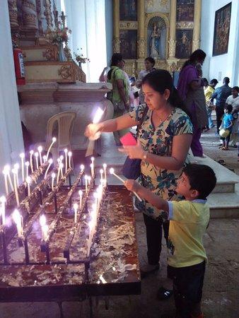Praying, Lighting Candles - Picture of St  Cajetan's Church, Panjim
