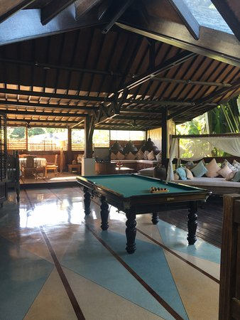 Taman Wana Ayurvedic Luxury Hotel and Villas in Seminyak: Just outside our room, pool table and day beds. Our room was called Lama 4.