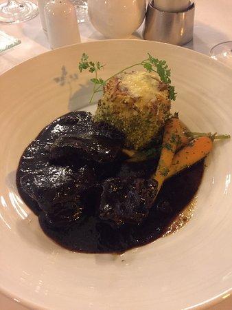 Sarah Bernhardt: Slow braised beef á la Niçoise with potato dauphinoise and Vichy carrots