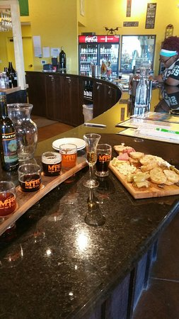 Petoskey, MI: This is the beer sampler with the farmers board and the sample of the ice wine