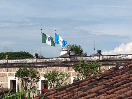 Hotel Casa del Parque: National flags flying on the Govt Building right around the corner