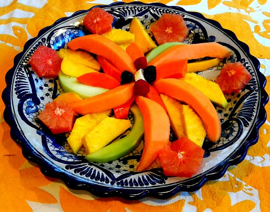 Casa Amor Del Sol: Fresh fruit served with hot entrees and fresh baked pastries and bread
