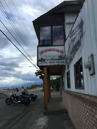 Motorcycle parking out front, Highwayman Saloon Bar & Grill, Union Bay, BC