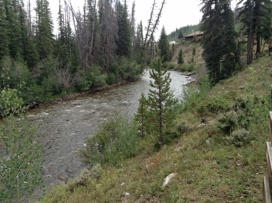 Parshall, CO: River running past the cabins and view of main lodge