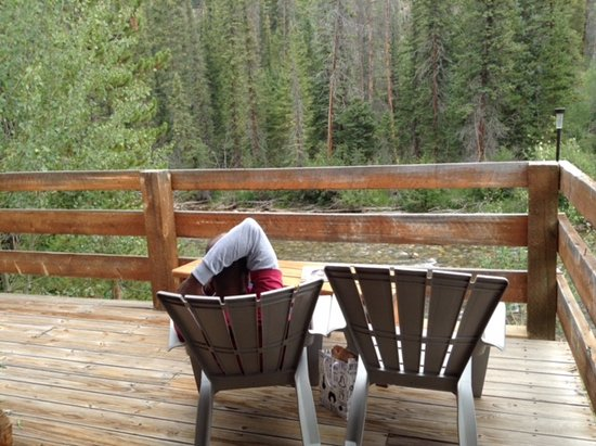 Parshall, CO: reclining on chairs on deck at cabin