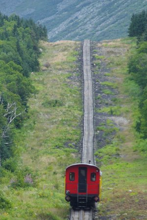 The Mount Washington Cog Railway : The train before ours, going up the mountain.