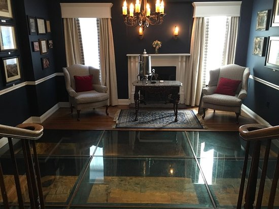 Historic Inns of Annapolis: Sitting room with glass floor exposing original foundation.