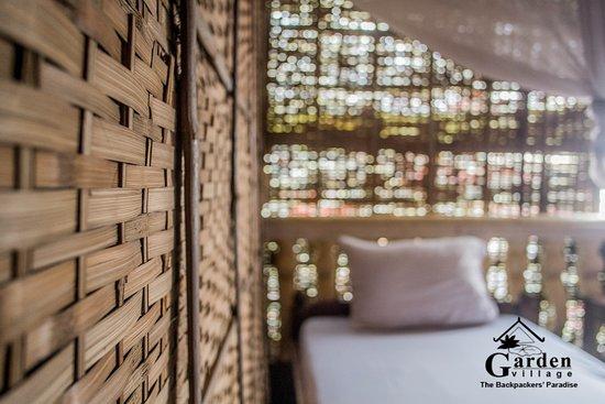 Garden village guesthouse budget bamboo room shared bathroom fan