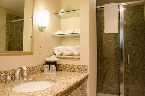 Pewaukee, WI: Well appointed bathrooms featuring granite countertops and showers