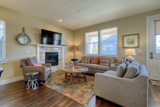 Cozy living room with gas fireplace in the Beach Cottage ...