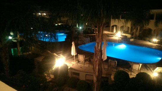 Aphrodite Sands Resort: What an amazing night view of the pool area.