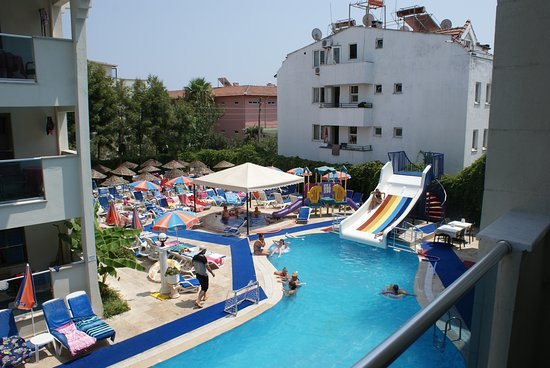 Club Evin Marmaris: view of pool and one of several poolside areas from our balcony.