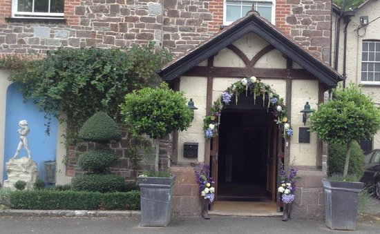 The Hartnoll Hotel: the arch decorated by the florist - half swag and purple wellies