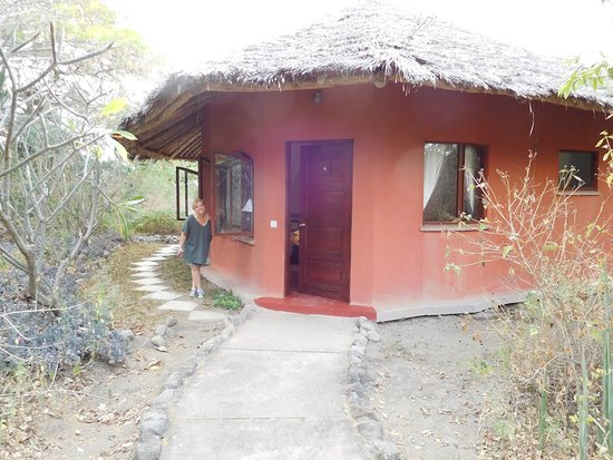 Kia Lodge – Kilimanjaro Airport: Robin next to our bungalow