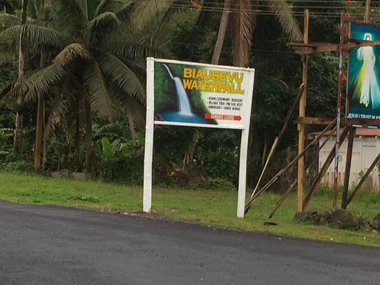 Adventures in Paradise Fiji: Biausevu Waterfalls sign on the side of the road
