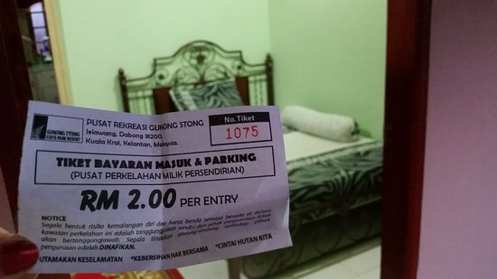 Gunung Stong: My waterfall ticket and in the background my luscious room at Rose House Dabong!