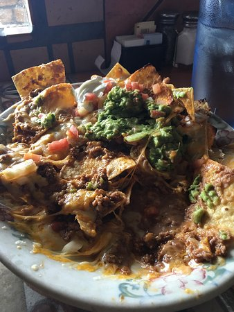 Conifer, CO: Beef super nachos and chicken taquitos. Chicken was a little dry and the beef in the nachos was