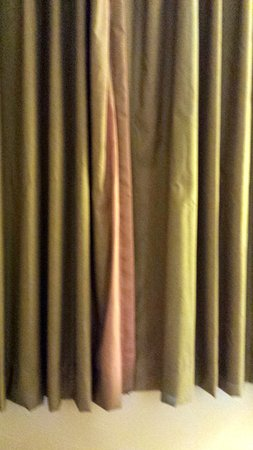 Days Inn by Wyndham Branson/Near the Strip: Sun faded curtains in our first room