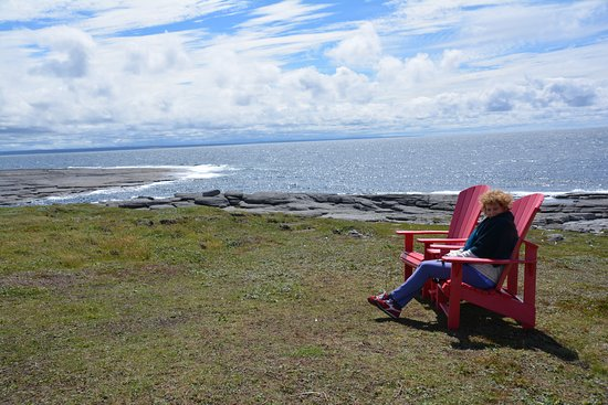Point Riche Lighthouse: Pointe Riche Red Chairs