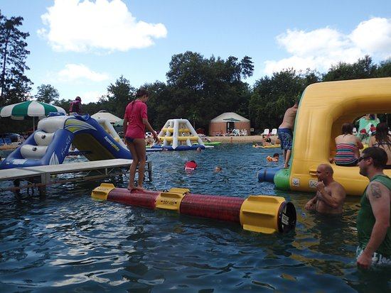 Lodi, WI: Lake inflatables and log (left side)