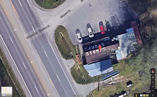 Right on HWY 146 in Bacliff, Look for the STOMPS on the roof