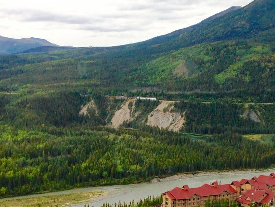Grande Denali Lodge: View of train pulling into Denali National Park above Horseshoe Lake and Nenana River.