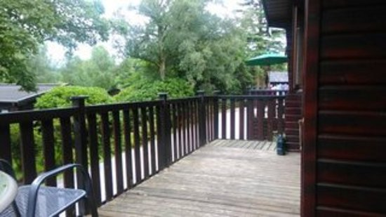 Burnside Park: Decking and outdoor seating area on lodge front.