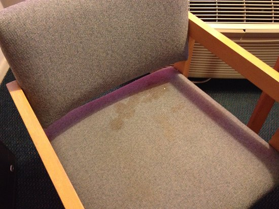 Belton, TX: Example of room condition (stain in chair)