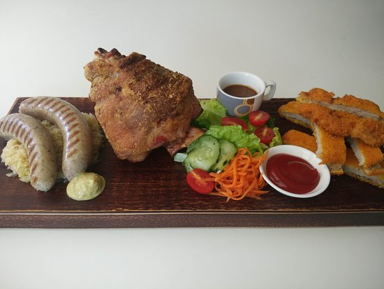 "Odenwalder Restaurant Bar: Our famous crispy pork knuckle ""Haxe""."