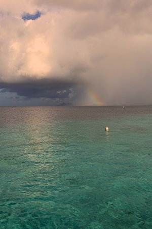 Black Durgon Inn : Distant storm, and rainbow, from dock