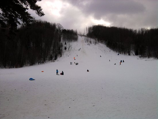 Boyne City, MI: Sledding down the face of the mountaiin