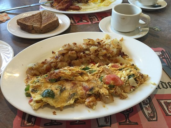 Bohemia, NY: Veggie Omelet with feta cheese, home fries and rye toast