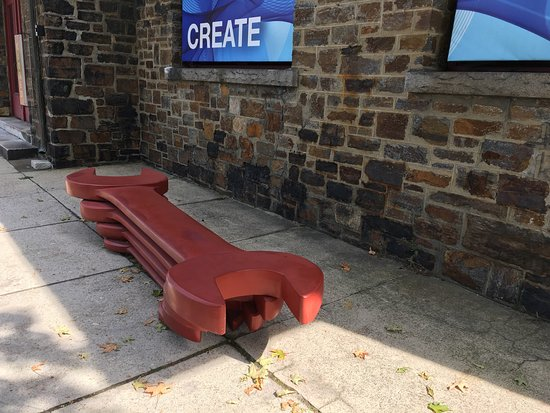 Brattleboro Museum and Art Center: Guns exhibit pieces and bench outside Art Center
