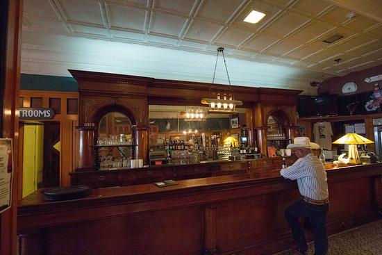 Hotel Eklund Restaurant: Original 1892 bar with a real cowboy have a cold one.