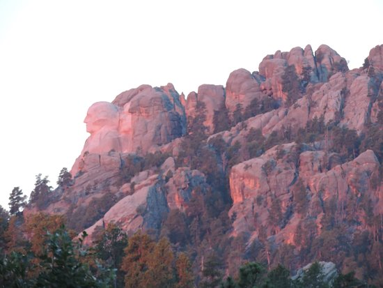 K Bar S Lodge: Enlarged photo of Rushmore sunrise as viewed from our room