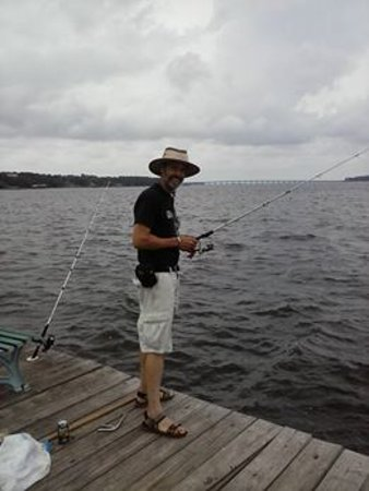 Keith FIshing on Pier of KOA Lillian, AL.