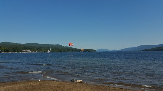 Twin Pines onTrout Lake: Beach at nearby Lake George Village. Parasailing!