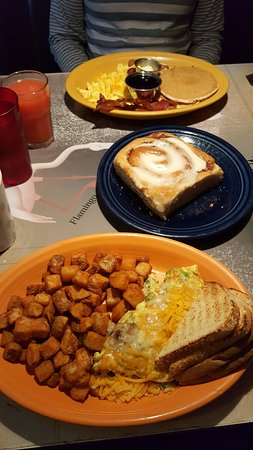 The Broken Yolk Cafe: cheesy avocado, onion & pepper omelet with home fries and sourdough. Choc chip pancakes, eggs, e