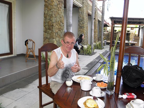 Sindhu Mertha Sanur: My visiting brother enjoying breakfast by the pool
