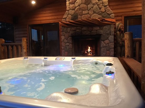 Evart, MI: Hot tub with fire lite on the front porch