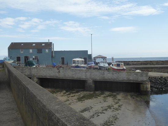 St Monans, UK: The smoke house is a focal point to St. Monan's harbour