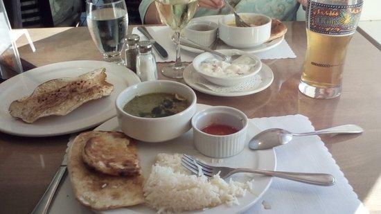 Green Curry Lamb, veggies in yogurt, rice, nam bread, lentile crisp, buttered chicken, wine, bee