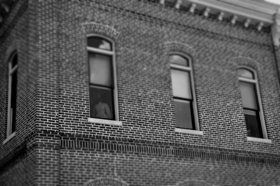 Powhatan, AR: Headless mannequin in window of the haunted courthouse.