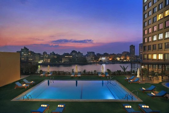 Hilton Cairo World Trade Center Residences: Pool at Sunset