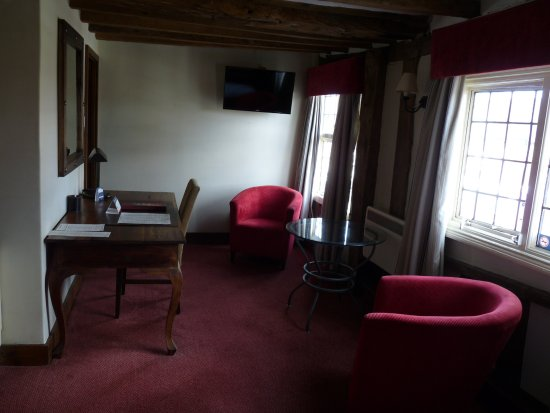 Ye Olde Dog & Partridge: The relaxation part of the room with wall TV, writing desk and easy chairs