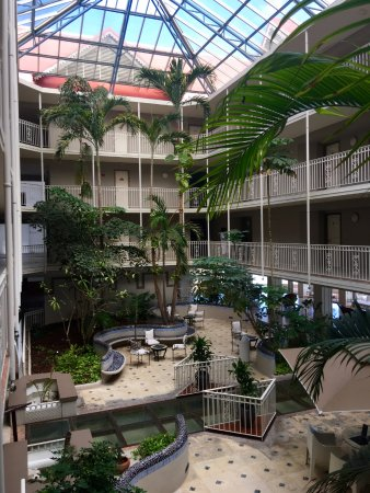Le Beach Hotel: The lobby area has nice plants and a glass walkway that shows signs of use.