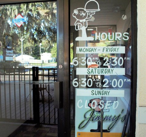 New Port Richey, FL: Front doors...hours of operation
