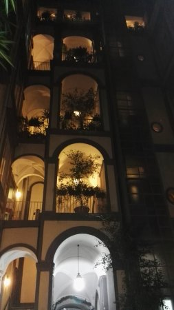 Chiaja Hotel de Charme: Enter through the gate at Via Chiaja to a small courtyard, hotel is located on first floor